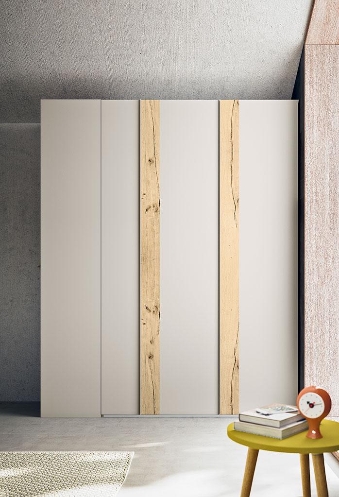 L'armadio Slim-Battente è disponibile in melaminico e laccato, con inserti anche in legno