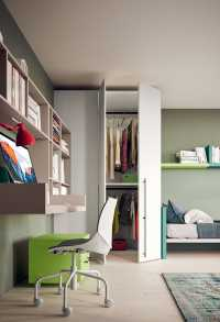 Lite walk-in wardrobe has a small dressing area just behind its doors