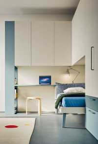 Overbed units with bookcase end unit and integrated desk