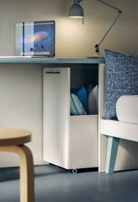 The end of bed desk hides a spacious cabinet underneath