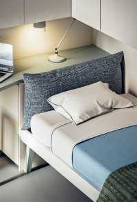 Botton bed with upholstered headboard can be positioned in many ways
