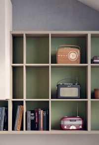 Detail of the wall mounted bookshelf in two colours