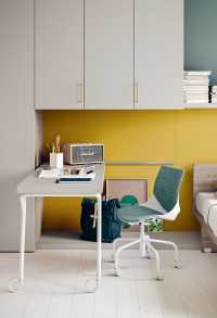 The desk moves forward and backward thanks to casters and a sliding track built in on the wall paneling