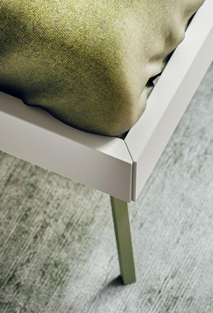 The bed frame features Kios sleek metal legs