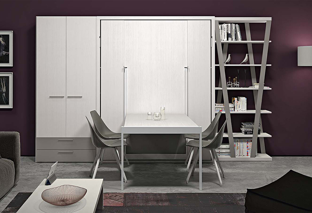 Arredamento soggiorno con armadio, letto a scomparsa con tavolo, libreria