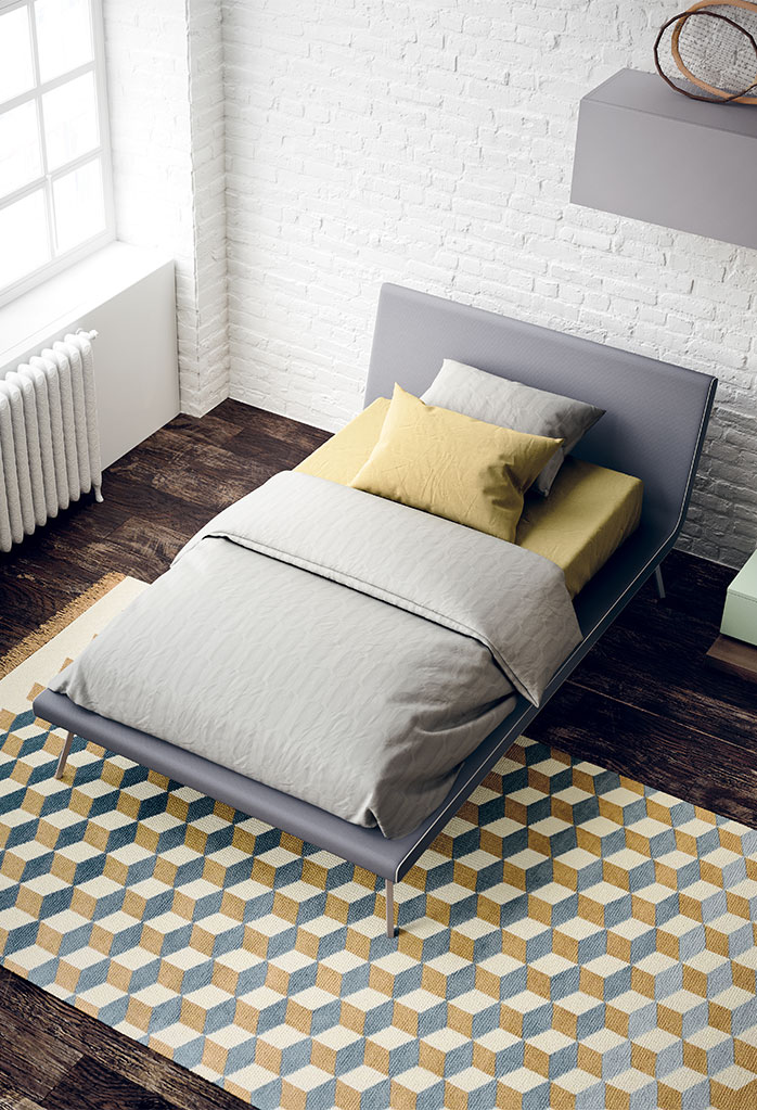 Slitta is a single upholstered bed with tall sleek legs