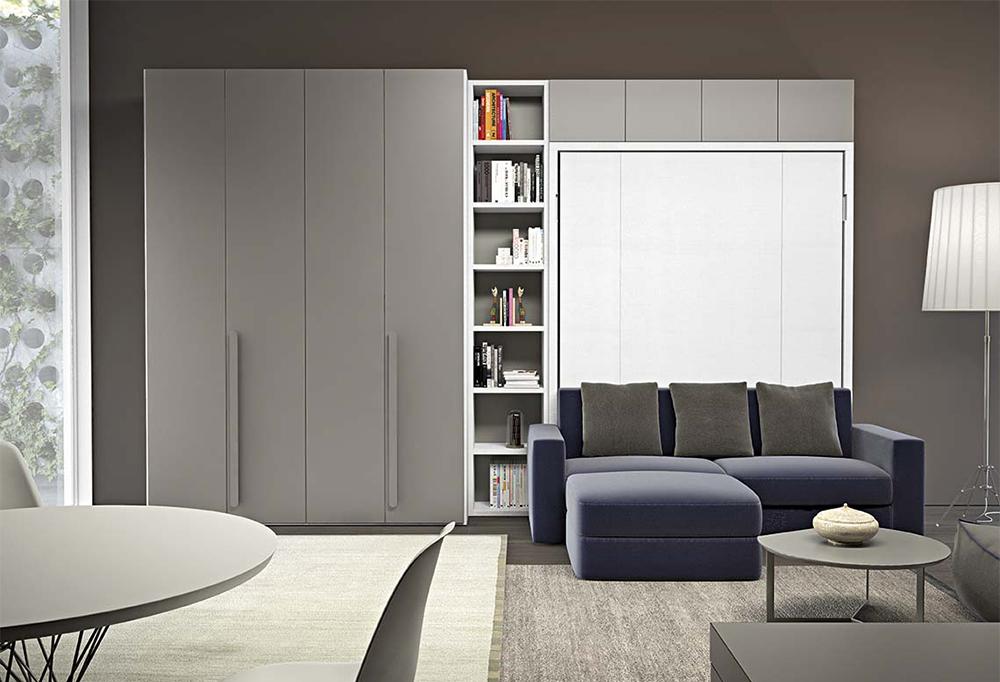 Parete attrezzata trasformabile con armadio, colonna libreria e letto a scomparsa