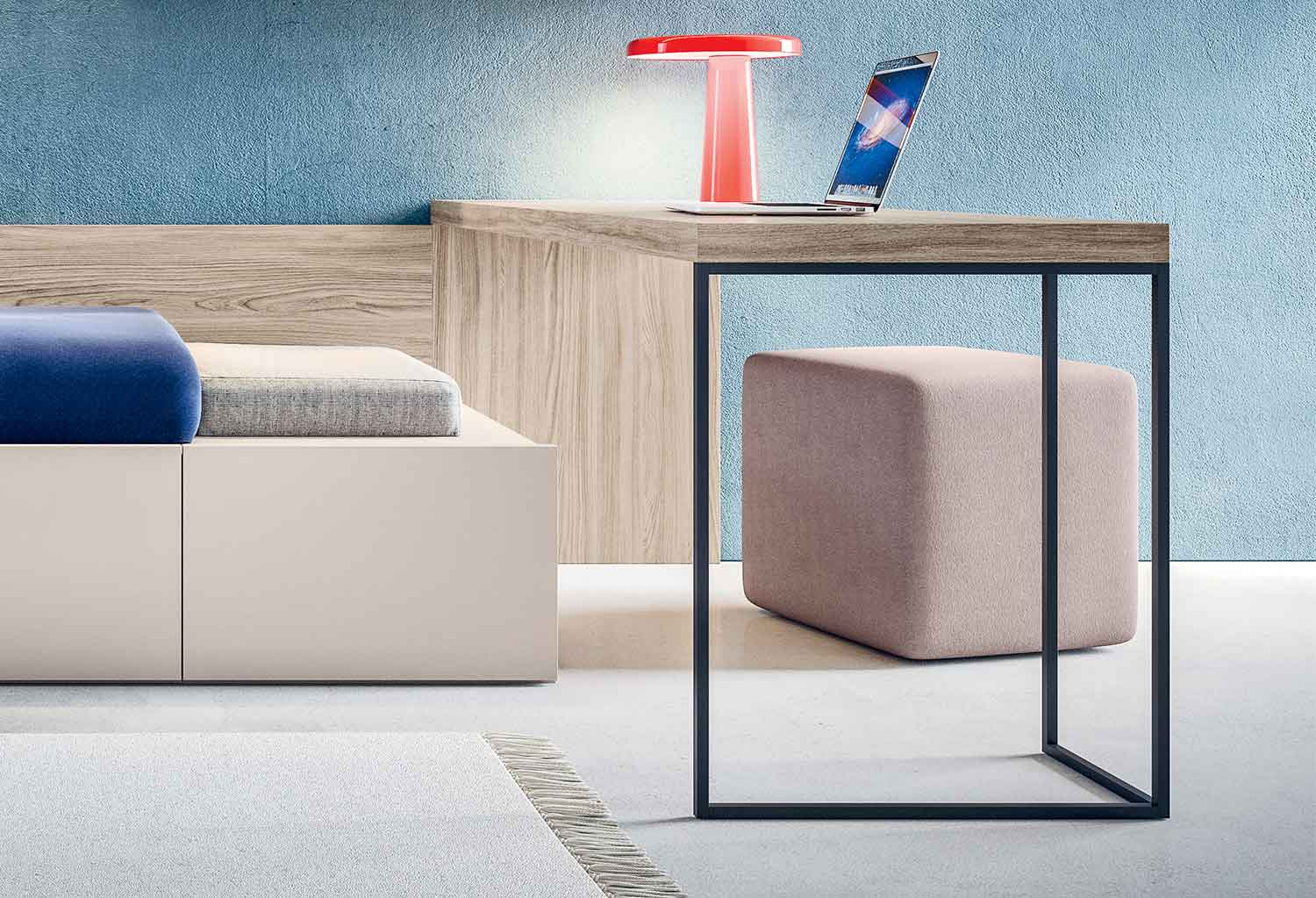 The Kios desk is here integrated with a wall panel and single bed